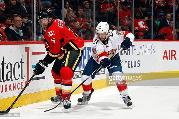 Brodie of the Calgary Flames skates against Vincent Trocheck of the Florida Panthers during an NHL game on January 17 2017 at the Scotiabank...