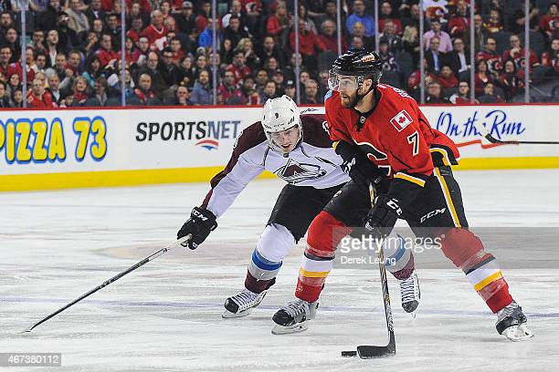 J Brodie of the Calgary Flames skates past Matt Duchene of the Colorado Avalanche during an NHL game at Scotiabank Saddledome on March 23 2015 in...