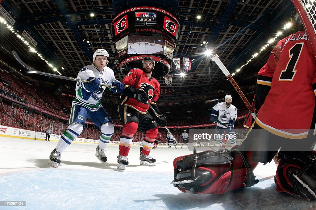 TJ Brodie #7 of the Calgary Flames skates to the net against Derek Dorsett #51 of the Vancouver Canucks at Scotiabank Saddledome for Game Four of the Western Quarterfinals during the 2015 NHL Stanley Cup Playoffs on April 21, 2015 in Calgary, Alberta, Canada.
