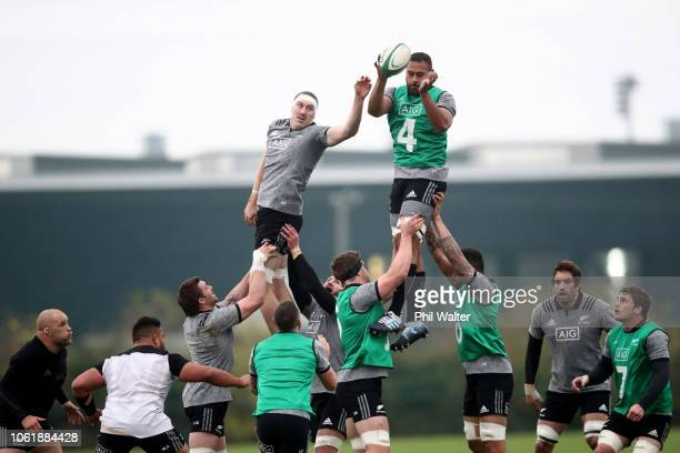 Brodie Retallick and Patrick Tuipulotu of the All Blacks reach for the ball during a New Zealand All Black training session at the Ireland Sport...