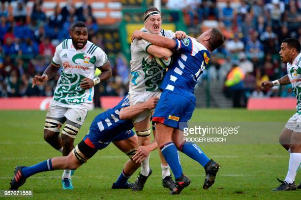 Brodie Retallick lock of the the Chiefs from New Zealand is tackled by Jakobus Janse van Rensburg of the Stormers from South Africa during the Super...