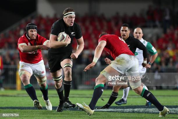 Brodie Retallick of the All Blacks is tackled by Alun Wyn Jones of the Lions during the Test match between the New Zealand All Blacks and the British...