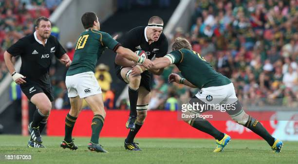 Brodie Retallick of the All Blacks is tackled by Morne Steyne and Duane Vermeulen during the Rugby Championship match between South Africa Springboks...