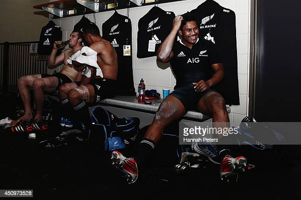 Brodie Retallick of the All Blacks Jerome Kaino and Julian Savea of the All Blacks relax in the dressing room after winning the International Test...
