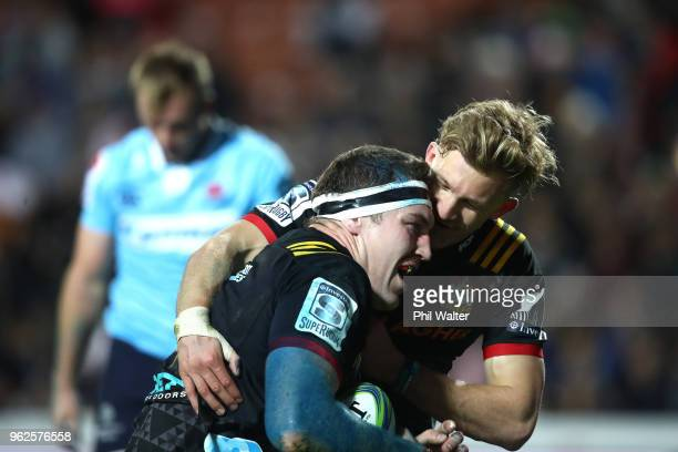 Brodie Retallick of the Chiefs is congreatulated on his try by Damian McKenzie during the round 15 Super Rugby match between the Chiefs and the...