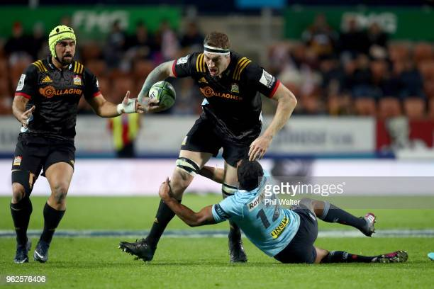 Brodie Retallick of the Chiefs is tackled during the round 15 Super Rugby match between the Chiefs and the Waratahs at FMG Stadium on May 26 2018 in...