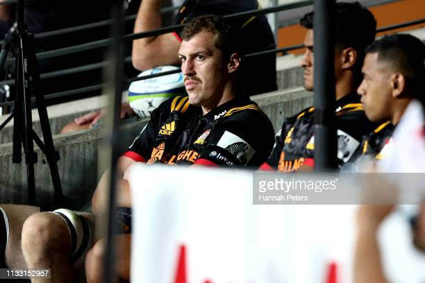 Brodie Retallick of the Chiefs looks on from the bench during the round three Super Rugby match between the Chiefs and the Sunwolves at FMG Stadium...