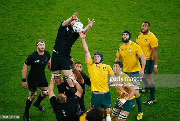 Brodie Retallick of the New Zealand All Blacks wins a lineout from Dean Mumm of Australia during the 2015 Rugby World Cup Final match between New...