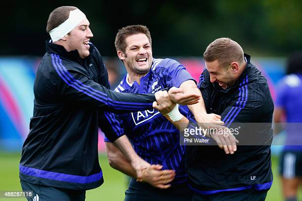 Brodie Retallick Richie McCaw and Luke Romano of the All Blacks warm up during a New Zealand All Blacks training session on September 15 2015 in...