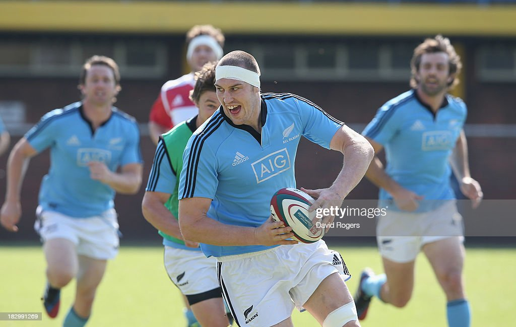Brodie Retallick runs with the ball during the New Zealand All Blacks training session held at Wits University on October 3, 2013 in Johannesburg, South Africa.