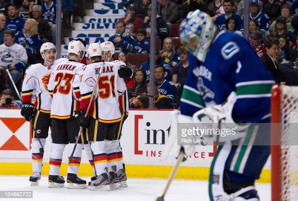 TJ Brodie Scott Hannan Roman Horak and Rene Bourque of the Calgary Flames celebrate teammate Alex Tanguay's goal against goalie Roberto Luongo of the...