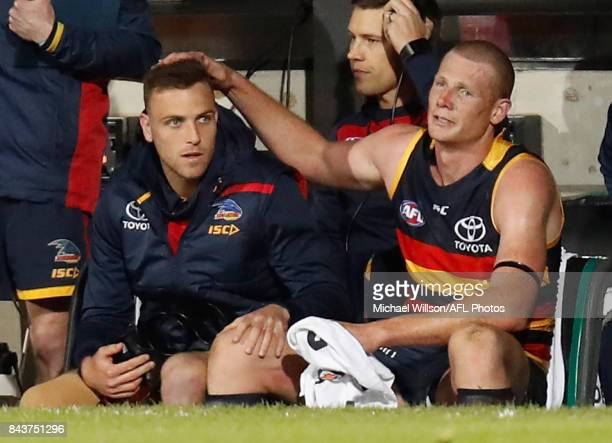 Brodie Smith of the Crows and an emotional Sam Jacobs of the Crows embrace each other as the final siren sounds during the AFL First Qualifying Final...