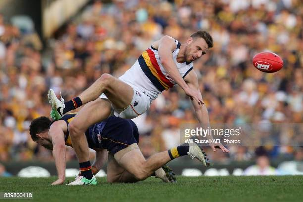Brodie Smith of the Crows and Luke Shuey of the Eagles challenge for the ball during the round 23 AFL match between the West Coast Eagles and the...