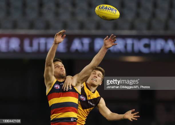 Brodie Smith of the Crows flys for a mark during the round 20 AFL match between Adelaide Crows and Hawthorn Hawks at Marvel Stadium on July 24, 2021...