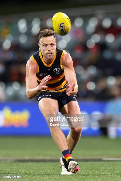 Brodie Smith of the Crows marks the ball during the round 23 AFL match between Adelaide Crows and North Melbourne Kangaroos at Adelaide Oval on...