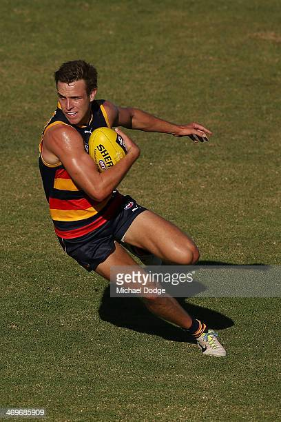 Brodie Smith of the Crows runs with the ball during the round two AFL NAB Challenge Cup match between the Adelaide Crows and the Port Adelaide Power...