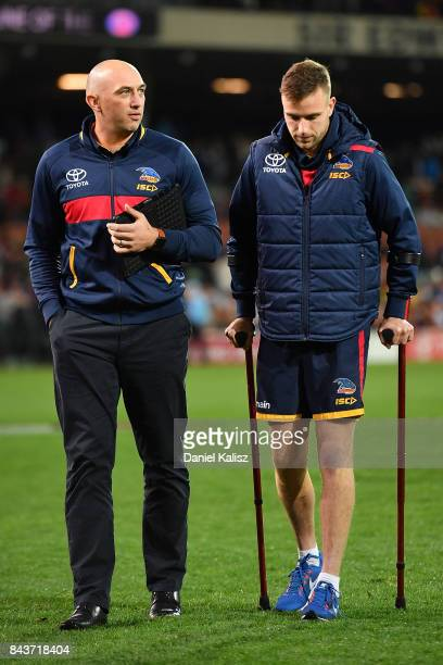 Brodie Smith of the Crows walks from the field with a suspected knee injury after the AFL First Qualifying Final match between the Adelaide Crows and...