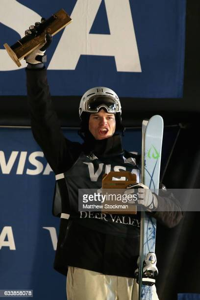 Brodie Summers of Australia celebrates on the medals podium after finishing third in the Men's Dual Moguls during the FIS Freestyle World Cup at Deer...