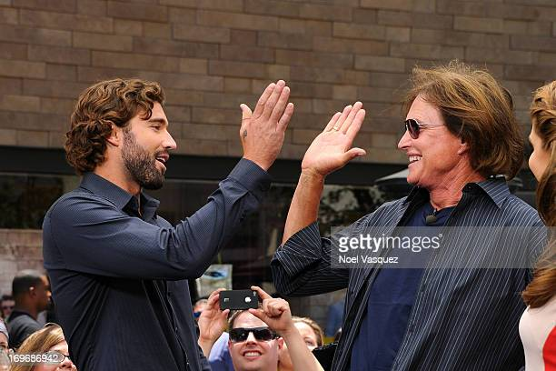 Brody Jenner and Bruce Jenner visit 'Extra' at The Grove on May 30 2013 in Los Angeles California