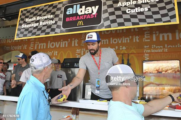 Brody Jenner serves an Egg McMuffin to race fans from McDonald's McRig during the Daytona 500 at Daytona International Speedway on February 21 2016...