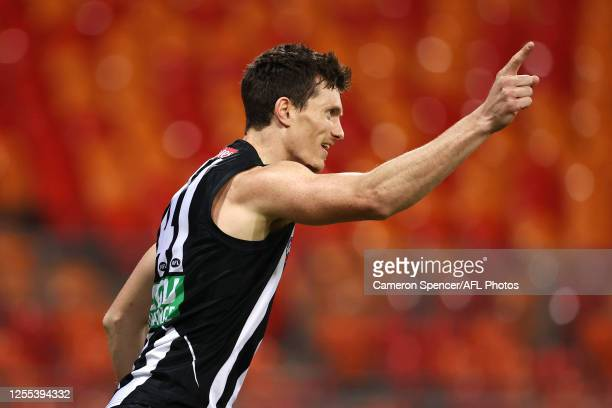 Brody Mihocek of the Magpies celebrates kicking a goal during the round 6 AFL match between the Collingwood Magpies and the Hawthorn Hawks at GIANTS...