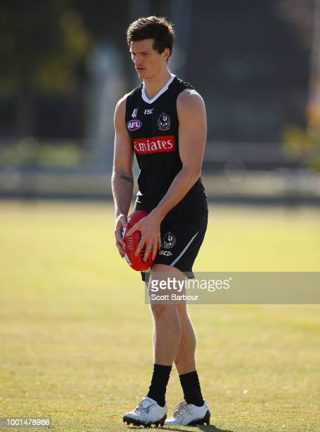 Brody Mihocek of the Magpies runs with the ball Nathan Buckley speaks to the media during a Collingwood Magpies AFL media opportunity / XXXX competes...