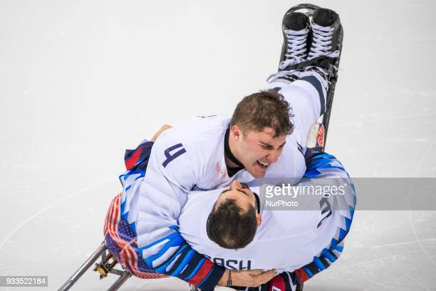 Brody ROYBAL and Steve CASH celebrate winning the gold medal over Canada in the Ice Hockey gold medal game between Canada and United States during...