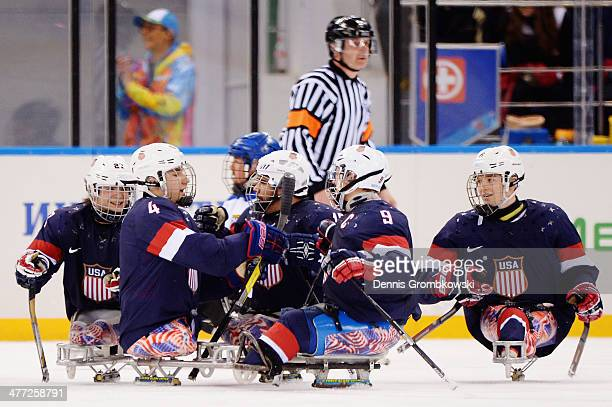 Brody Roybal of the United States celebrates with team mates after scoring a goal during the Ice Sledge Hockey Preliminary Round Group A match...