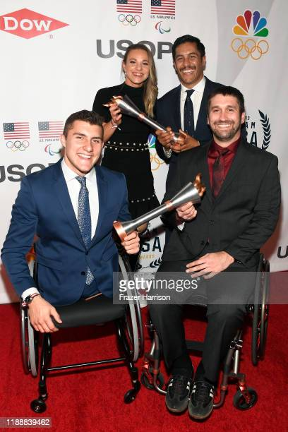 Brody Roybal Oksana Masters Rico Roman and Ben Thompson pose with their awards during the 2019 Team USA Awards at Universal Studios Hollywood on...