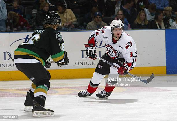 Brody Todd of the Ottawa 67s gets challenged by Steve Ferry of the London Knights during a Ontario Hockey League game at John Labatt Centre on...