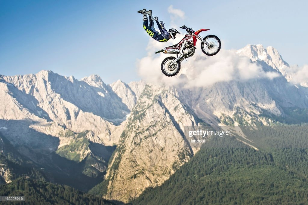 Brody Wilson of the United States of America performs in front of the Zugspitze, the highest mountain in Germany, prior to the upcoming fourth stage of the Red Bull X-Fighters World Tour in Munich on July 16, 2014 in Garmisch, Germany.