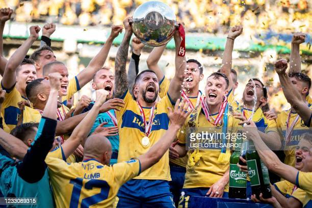 Broendby's Anthony Jung and teammates celebrate with the trophy after winning the Danish Football Championship Superliga after the Super League...