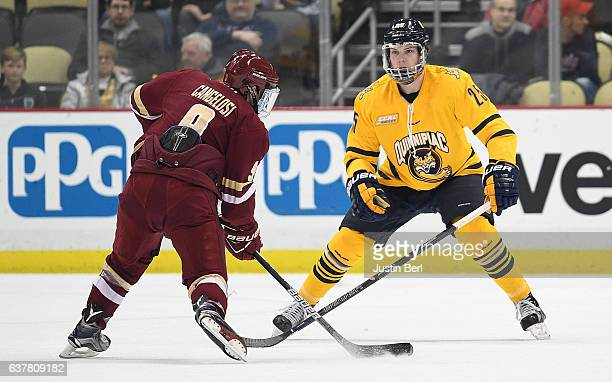 Brogan Rafferty of the Quinnipiac Bobcats defends against Austin Cangelosi of the Boston College Eagles in the first period during game one of the...