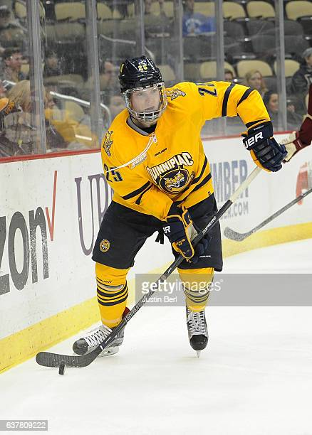 Brogan Rafferty of the Quinnipiac Bobcats skates with the puck in the second period during game one of the Three Rivers Classic hockey tournament at...