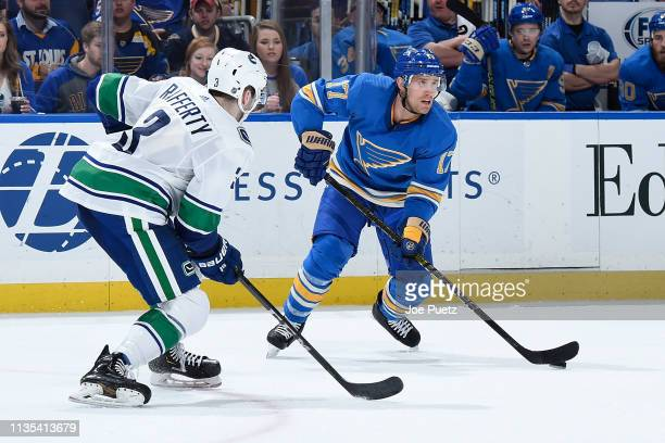 Brogan Rafferty of the Vancouver Canucks defends against Jaden Schwartz of the St Louis Blues at Enterprise Center on April 6 2019 in St Louis...