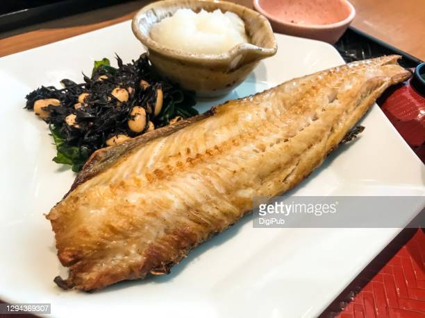 broiled atka mackerel served with grated daikon - 煮物 ストックフォトと画像