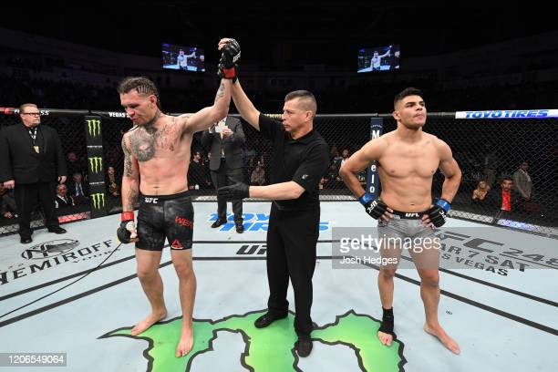 Brok Weaver is delcared the winner after Kazula Vargas of Mexico is disqualified for an illegal knee in their lightweight bout during the UFC Fight...