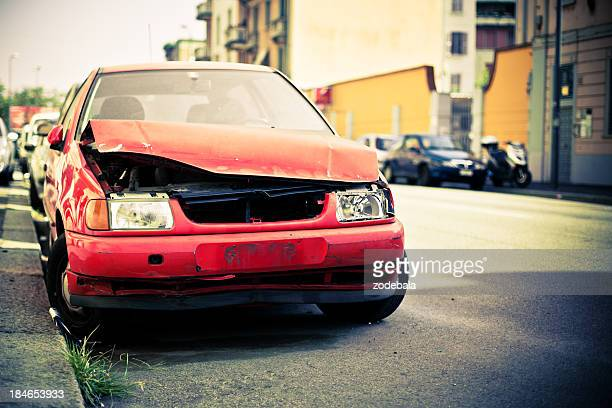 Broken Abandoned Car on the Street