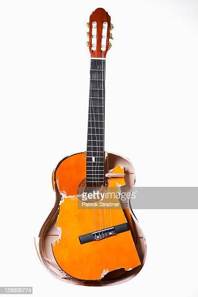 A broken acoustic guitar