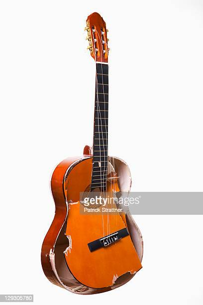 a broken acoustic guitar - acoustic guitar stock pictures, royalty-free photos & images