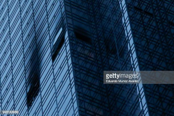 Broken and burned windows are seen after a fire broke out on the 50th floor of Trump Tower on April 7 2018 in New York City One person has reportedly...