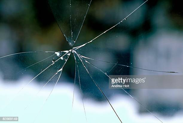 Broken and cracked glass window with sharp edges