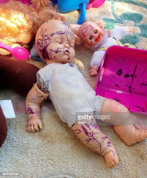 Broken and macabre dolls