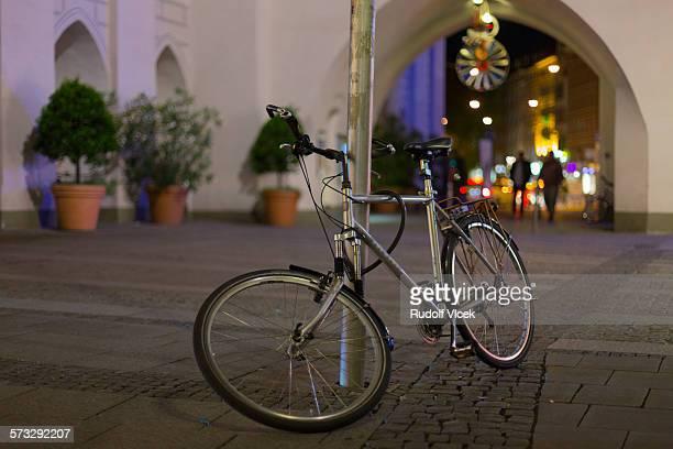 Broken bicycle on a night street