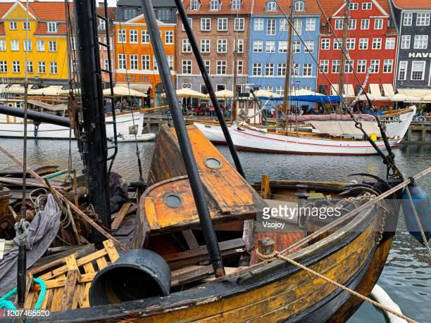 a broken boat at the nyhavn harbour, copenhagen, denmark - vsojoy stock pictures, royalty-free photos & images