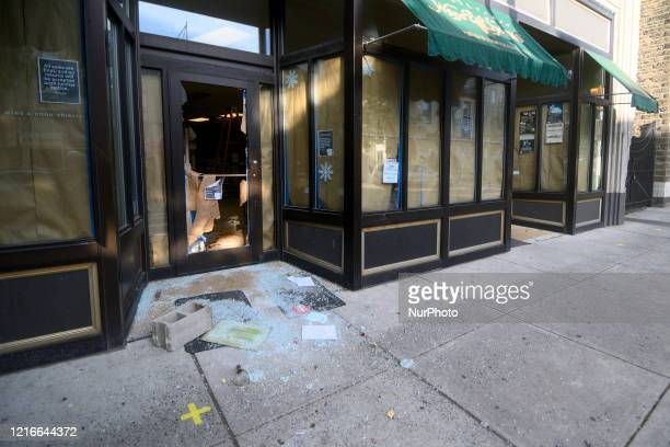 A broken bottle and glass lays in front of a stateowned wine and liquor store after it is vandalized overnight in the Mt Airy neighborhood in...
