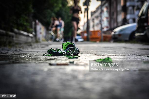 Broken Bottle On Sidewalk