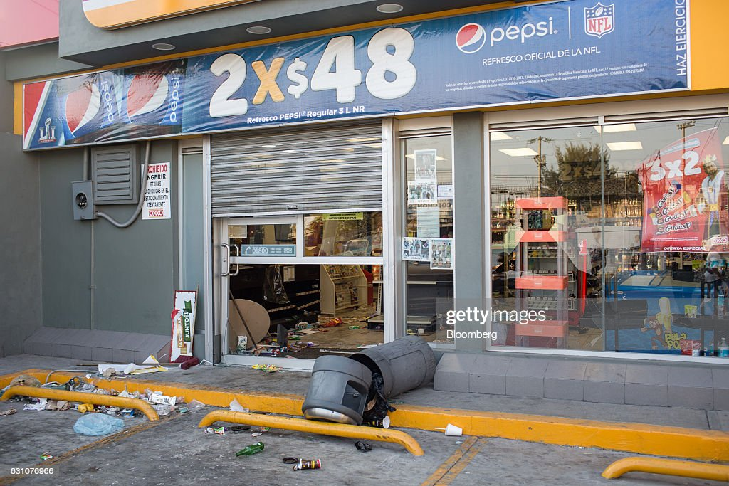 Broken Bottles And Trash Sit Outside An OXXO Convenient Store Following  Looting And Protests Over The