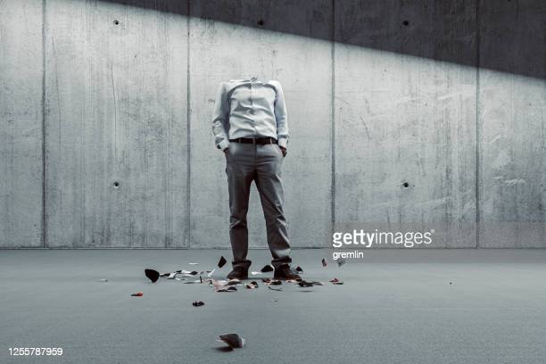 broken businessman against concrete wall - breaking stock pictures, royalty-free photos & images