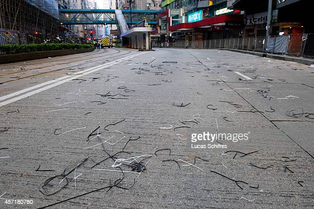 Broken cable ties, once used to hold together barricades, sit on Hennessy Road in former 'Occupy Central' camp in Causeway Bay on October 14, 2014 in...